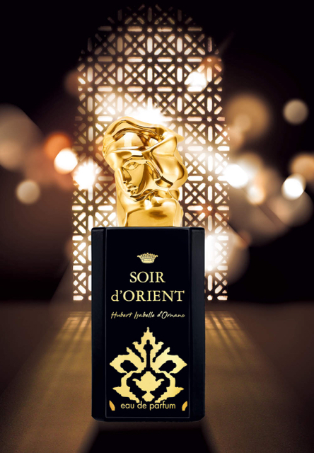 Bottle of Sisley Soir d'Orient perfume against lattice background